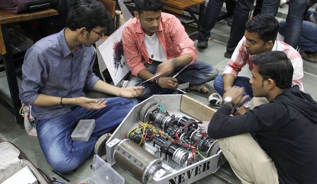 Participants preparing their Robots for Robo War in the Asia's Largest Science and Technology festival  at the campus of IIT Bombay at Powai, Mumbai.